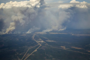View of the wildfire on May 4, 2016 as it surrounds the city of Fort McMurray. The fire remains out of control and is now 5820 sq. km. Photo Credit: Jeff McIntosh, Canadian Press